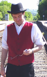 Greg checking his pocket watch